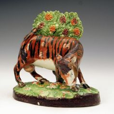 STAFFORDSHIRE POTTERY FIGURE OF A BULL WITH BOCAGE