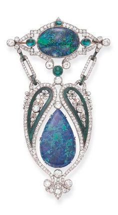 A BELLE EPOQUE GEM-SET ENAMEL BROOCH Designed as an independently-set pear-shaped cabochon opal, within an openwork old European-cut diamond surround, enhanced by green enamel paisleys, each centering upon an old European-cut diamond single-cut emerald foliate motif, from a navette-shaped old European-cut diamond plaque, centering upon an oval cabochon opal, accented by cabochon emeralds, mounted in platinum, circa 1915.
