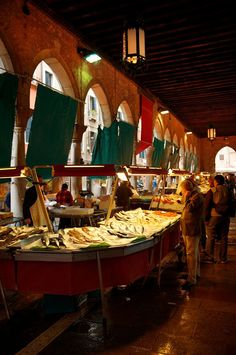 Italia Tour Italy| Serafini Amelia| Fish stalls in the Rialto Market - Venice Italy