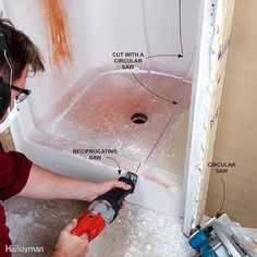 Some bathrooms are built around a shower or tub surround. This means that even if you manage to remove all the fasteners holding it in place, the odds are you're not getting that surround out the door in one piece. You're going to have to dice it up. Make the long cuts with a circular saw, and finish the curved areas with a recip saw. Wear eye protection because fiberglass throws a bunch of chips when it's cut. And a dust mask is a must—fiberglass dust is not something you want to breathe…