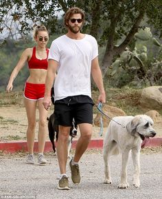 Puppy love: Miley Cyrus and Liam Hemsworth enjoyed an afternoon hike in Los Angeles on Saturday with their two dogs, a Pit Bull rescue named Mary Jane and Labradoodle Dora