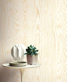 Golden wood grain wallpaper from Wallquest's collection Structure. Industrial inspired wallpaper.