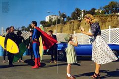 """Supermom"": Carolyn Murphy and David Gandy Play Lois Lane and Superman for Mario Testino for US Vogue"