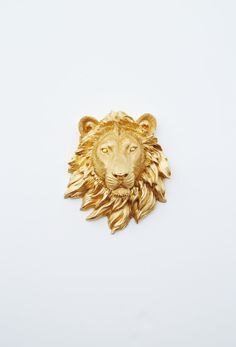 The Rico - 1 Gold Mini Resin Lion Head - Resin Gold Faux Taxidermy- Chic & Trendy. $29.99, via Etsy.
