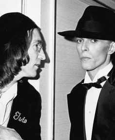 Lennon & Bowie- I don't know how I've never seen this pic! And John is wearing a jacket that says Elvis!!