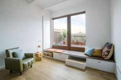 Nook Architects add patterned floor tiles and window seat to Barcelona apartment. Nook Architects add patterned floor tiles and window seat to Barcelona apartment renovation Nook Architects, Architects Journal, Minimalist Window, Window Seat Kitchen, Barcelona Apartment, Window Benches, Window Seats, Window Nooks, Patio Bench