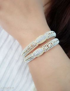 Bangles & Bracelets Trendy American Diamond Bangle  *Material* American Diamond  *Size* 2.4 , 2.6 , 2.8 , 2.10  *Description* It Has 1 Pair Of Bangle  *Work* Stone Work  *Sizes Available* 2.4, 2.6, 2.8, 2.10 *    Catalog Name: Valentine'S Day Special: Stylish Elegant American Diamond Bangles CatalogID_124001 C77-SC1094 Code: 392-1026310-