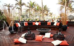 Red, white & black lounge on a beautiful deck