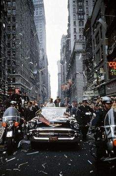 USA. New York City. 1960. Senator John F. KENNEDY and Jacqueline KENNEDY campaign during a ticker tape parade in Manhattan.