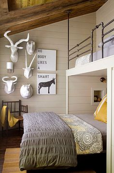 Rustic Bunk Room with funny artwork. Gray and yellow bedroom with barn board ceilings over gray shiplap clad walls accented with a variety of faux taxidermy alongside Nobody Likes A Smart Ass Art. Guest Bedroom Decor, Cozy Bedroom, Guest Room, Bedroom Ideas, Kids Bedroom, Cozy Cottage, Cozy House, Cozy Cabin, New England Homes