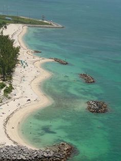 Fort Zachary Taylor State Park and Beach- Best beach in Key West. The water is clear and the bottom is rocky, which makes this a good place to snorkel and see tropical fish and live coral. Because of those rocks, it's smart to bring water shoes. The state park offers shady areas to relax and the historic fort is worth exploring. Parking available. The beachfront Cayo Hueso Café offers sandwiches, snacks, cold beverages served on a patio overlooking the beach.