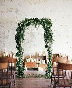 30 Winter Wedding Arches And Altars To Get Inspired: #5. Green leaves and some small white flowers on top is a cool idea for every indoor ceremony
