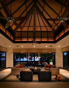 Modern living room with a dramatic pitched high ceiling and large windows