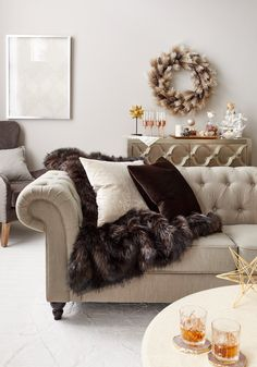 Adding a few simple touches can transition your home from fall to holiday in no time and on a small budget. Try introducing textures like lush faux fur, warm metallics and extra pillows for an inviting, get cozy feeling.