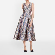 AW16 welcomes a vivid new print, seen here upon the Sulan dress. A striking forma option, this beautifully silhouetted style has a V neck and back, cinched waist, and a full skirt that falls in gentle pleats. When accessorising, keep things simple; a simple envelope clutch and metallic sandals work well.
