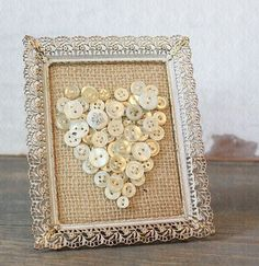 Arrange buttons in a heart shape in a vintage frame   Find vintage and new buttons at Nanalulus Linens and Handkerchiefs