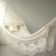 Luxurious Hammock   But you can also refinish you hammock with a bed sheet and lacing from a craft store