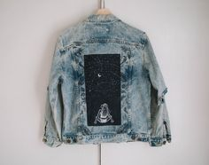 Size MOne of a kind Vintage denim jacket, hand painted with Tulip fabric paints in an original MindWerl design. To find each jacket I spend hours scouring second hand and vintage shops, then more hours carefully painting each original design onto the denim with the greatest attention to detail. When you purchase a MindWerl jacket, you're not just getting something to wear, you're also getting a lovingly crafted unique piece of artwork. This jacket is comple...