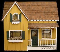 Dollhouse Number 3 - Farmhouse                 I like the stained glass windows