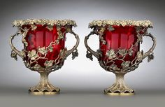 Silver Gilt and Red Crystal Wine Coolers fashioned in an intricate, openwork grapevine motif with their original ruby-red crystal inserts, circa 1900 | Exhibitor: MS Rau #AVENUE #silver #coolers