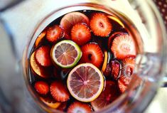 Easy Sangria /  1 bottle red wine (I used a cabernet)  1/2 cup rum (I used white rum)  1/2 cup sugar  12 ounces sparkling water  2 limes  2 lemons  2 oranges  1 cup sliced strawberries