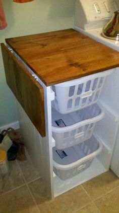 Laundry basket organizer with flip lid for folding. Great idea for a small space!