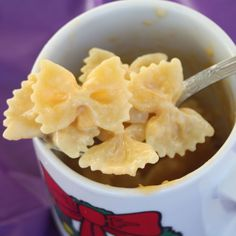 Add 1/3 cup of pasta and 1/2 cup of water in a mug. Microwave on high for 2 minutes ( the water will spill from the mug, this is expected) stir, microwave for another 2 minutes, stir, and you may need to do it another two minutes depending on your microwave. Add a little milk and a handful of cheese and stir