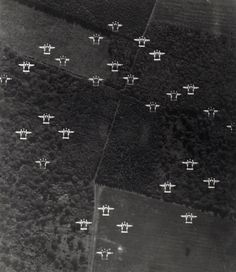 """Allied troops landed on the beaches of Normandy, France, supported by more than 5,000 ships and 11,000 aircraft. In an effort to prevent friendly fire during the D-Day invasion, each aircraft bore black and white """"invasion stripes"""" like the ones pictured on these Lockheed P-38 Lightnings."""