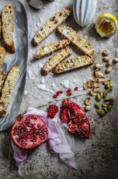 i really love biscotti they are so crunchy. these have lemon, pistachio nuts and pomegranate seeds with a tangy lemon icing.These twice bakes slices can be kept for a week for they would make a nice