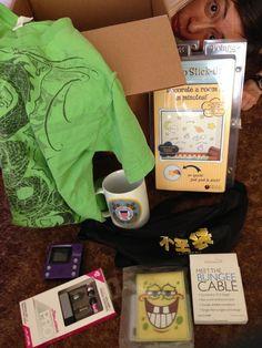 Meh 1 Apr 2015 Fukubukuro contents: green shirt, US Coast Guard mug, glow in the dark stickers, Meh fanny pack, ten foot long smartphone charger, spongebob wallet, ear phones, USB stick, and Halo video recorder