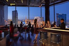 Get set for a glittering night with cool cocktails and stunning views through three walls of floor-to-ceiling windows