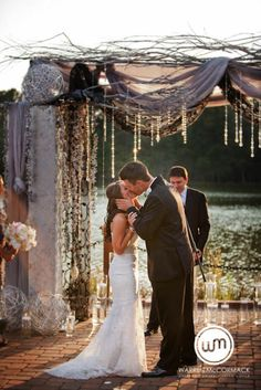 "Gorgeous ""golden hour"" wedding ceremony. I love that arch way, mainly the crystals other than that it's a little too mess even for me. 