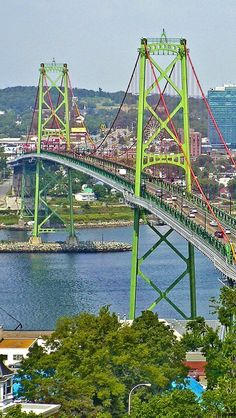 Angus L. Macdonald Bridge - a suspension bridge across Halifax Harbor between Halifax and Dartsmouth, Nova Scotia, Canada;  it is 4,277 feet long with a total height of 338 feet and is 154 feet above water in the center;  opened in 1955, it is locally known as 'the old bridge'    - Wikipedia