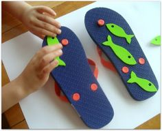 Putting the Foam Fish on the Flip Flops - fun summer painting