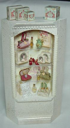 Ladies French Shabby-Chic shop Filled cabinet. Antique french baroque style in muted Creams/ Pinks / Golds.