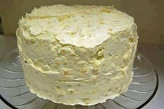 What you need:  This was my grandmother's favorite cake!  Mandarin Orange Pineapple Cake  1 box Duncan Hines Butter Cake mix  1/2 cup Wesson oil  1 11- ounce can mandarin oranges  1/2 cup sugar  4 eggs  Icing  1 12 ounce tub of Cool Whip  small instant