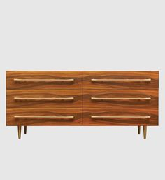 Handmade chest in Indian palisander with six drawers and bronze handles.