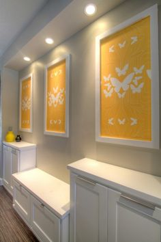 Kreme Life wallpaper, cut it out and installed directly on the wall. Painted 3 picture frames without the glass and pin nailed them up over the wallpaper