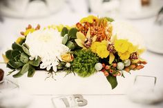 wedding centerpiece in yellow, green, and white