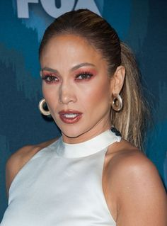 Channel '90s beauty like Jennifer Lopez by matching your metallic eye shadow to your lipstick.