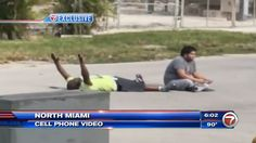 A black man who was caring for an autistic man has been shot by police in North Miami, while he was lying on the ground with his hands in the air.
