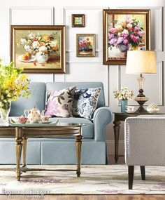 Wouldn't mom love this living room space? It's so light, airy and full of florals. This sofa looks so classic in the sky blue upholstery!