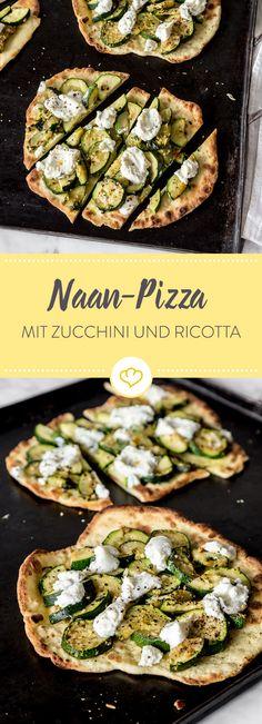 Belege das Naan-Fladenbrot mit Zucchini, Knoblauch un Kräutern und gebe zum Schluss noch cremigen Ricotta drüber. So einfach und so lecker!
