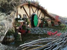 Another great view of a hobbit home in a truly lived-in setting, including the traditional circular doorway