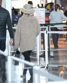 Fur baby: Jennifer teamed the stylish headwear with a matching fuzzy sweater as her prized...