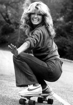 Farrah Fawcett (and all of Charlie's Angels for that matter) made fitted and flared jeans the style du jour for 1970s girls. Here she is in 1976.