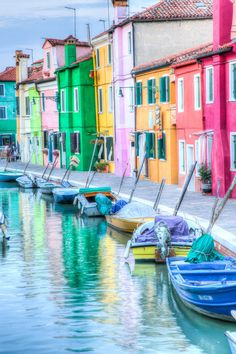 the fishermen on the island of Burano, Italy near Venice, paint their houses very colorfully so that they can spot them when they are out to sea