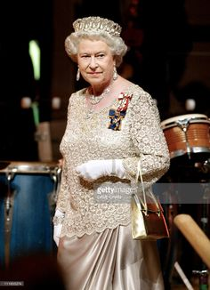 Britain's Queen Elizabeth II arrives for a gala dinner 13 October 2002 in Gatineau, Quebec, Canada. Queen Elizabeth II is on the last leg of her 11-day Golden Jubilee visit to Canada.