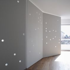 :: INTERIORS :: beautiful wall parition concept for dividing an interior. Featured on DEZEEN, Light glows through the circular holes to give a star-studded appearance to the walls, which were designed by French studio Cut Architectures. Photography is by David Foessel. #interiors