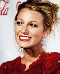 She could calm her smile down here, but it's cute because she's Blake Lively and she's being cheeky!